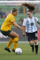 Hair-raising contest: Australia's Laura Alleway takes on Estefania Banini of Argentina during the Cup of Nations match at AAMI Park in Melbourne earlier this month.