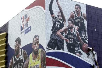 A billboard advertising an NBA preseason game between the Los Angeles Lakers and Brooklyn Nets in Shanghai.