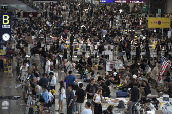 Protesters stage a sit-in rally at the arrival hall of the Hong Kong International Airport.