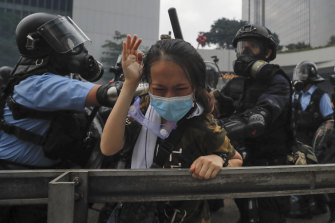 Riot police tackle a protester outside the Legislative Council in Hong Kong.