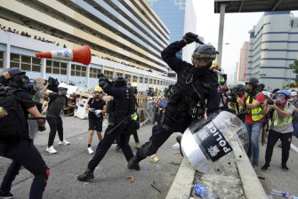 Police and demonstrators clash in Hong Kong on Saturday.