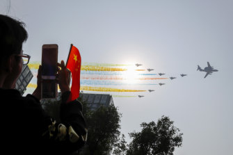 Chinese military planes fly in formation during a parade in Beijing to commemorate the 70th anniversary of the founding of communist China.