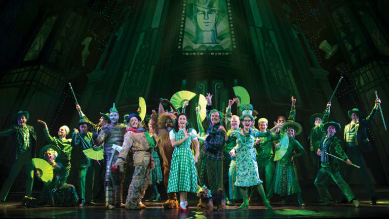 The ensemble of The Wizard of Oz performing Merry Old Land of Oz.