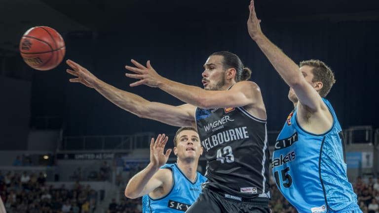 Quick hands: Melbourne captain Chris Goulding dishes off a pass from under the basket in the first semi-final against the NZ Breakers at Hisense Arena.