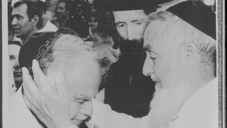 Israel's then Prime Minister Yitzhak Shamir (left) is blessed by Rabbi Menachem Abraham in 1984 while Rabbi Yitzhchak Dovid Grossman (also known as the Disco rabbi) looks on.