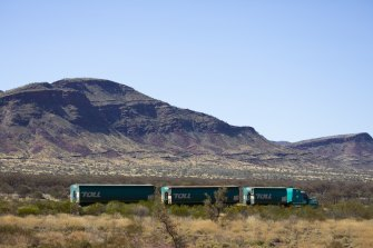 A road train on the outskirts of Karijini National Park near Tom Price in the Pilbara region of Western Australia. Miner Rio Tinto will help coordinate some COVID-19 vaccination clinics in the region this month.