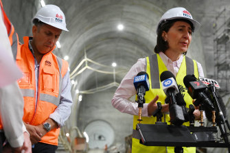 Business as usual: Gladys Berejiklian and Andrew Constance at the Martin Place Metro station on Thursday.