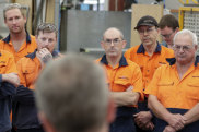 Opposition Leader Bill Shorten meets with workers at the Volgren bus facility in Perth, WA, on Wednesday.