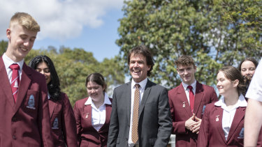 Jamison High School principal Glyn Trethewy with some of his students as they launched their new renewable energy system on Friday.