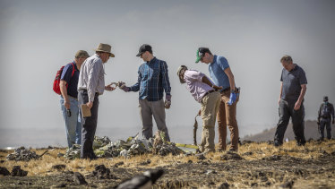 Foreign investigators examine wreckage at the scene where the Ethiopian Airlines Boeing 737 Max 8 crashed shortly after takeoff near Bishoftu, south of Addis Ababa, in Ethiopia.