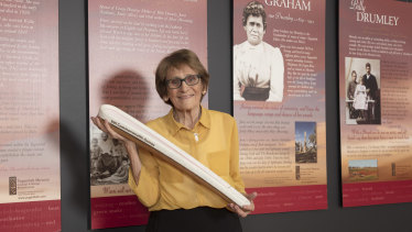 Patricia O'Connor holding the Queen's Baton from the 2018 Gold Coast Commonwealth Games.
