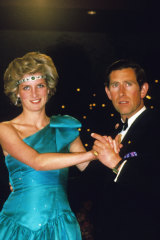 Charles and Diana, wearing Queen Mary's necklace as a headpiece, at a ball in Melbourne in October 1985.