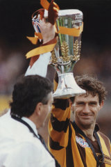 Hawthorn Captain Michael Tuck holding the premiership cup.