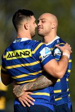 Give us a smooch ... Blake Ferguson and Ryan Matterson embrace before Eels training.