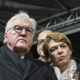 German President Frank-Walter Steinmeier and his wife Elke Buedenbender attend a vigil for the victims near the Midnight shisha bar, one of the sites of last night's shootings.