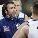 Cats coach Chris Scott addresses his players in the clash with the Bombers.