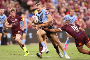 Out of the way ... Turbo in full flight in Townsville during Origin I.