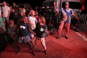 Children - and adults - danced as bands performed during a community celebration event.