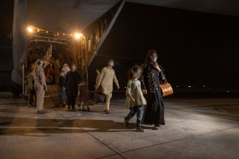 An RAAF C-130J Hercules evacuated 93 Afghans from Pakistan, who are now quarantining in Darwin.