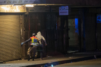 A police officer chases a man who violated the lockdown in Johannesburg, South Africa.