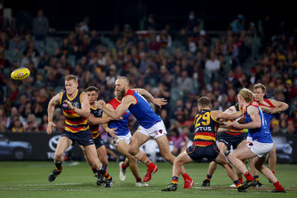 Reilly O'Brien of the Crows competes with Max Gawn.