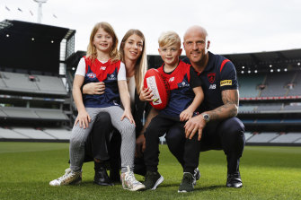 Nathan Jones with his wife Jerri and children Bobby and Remi ahead of his 300th game this weekend.