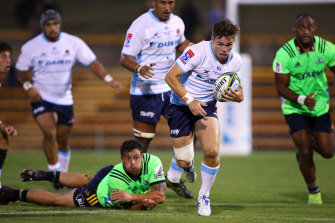 Playmaker Will Harrison skips away from the Highlanders defence.