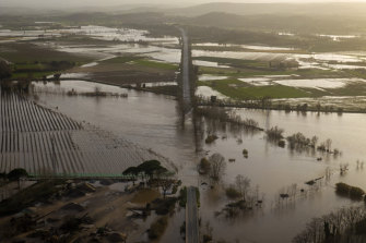 A road is flooded by the river Ter in Girona, Spain. The huge storm has caused sea water to inundate vast areas of agricultural land in the country's east.