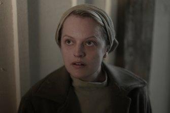 Elisabeth Moss  plays the enslaved June Osborne in The Handmaid's Tale.