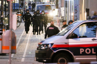 Police patrol at the scene early on Tuesday following an attack on people enjoying a last evening out before lockdown in Vienna.