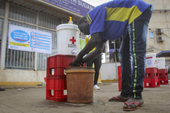 A man washes his hands to stop the spread of the new coronavirus in Juba, South Sudan. South Sudan announced its first case of COVID-19 on Sunday, making it the 51st of 54 African countries to report the disease.