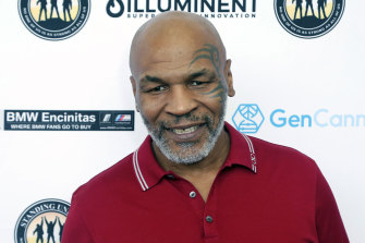 Mike Tyson at a celebrity golf event last year. Tyson will fight in an exhibition match against Roy Jones jnr next weekend.