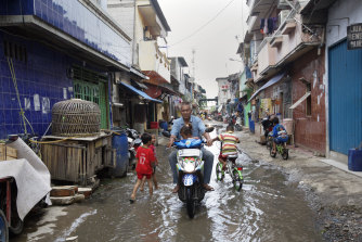 A flooded street in the Muara Baru district of Jakarta back in 2015.