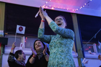 Members of IA (Inuit Ataqatigiit) celebrate the party's strong showing in the election.