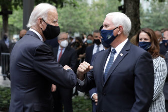 Joe Biden and Mike Pence bump elbows at the 9/11 memorial in New York.