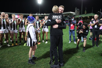 Nathan Buckley celebrates with his sons.