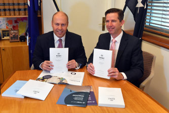 Treasurer Josh Frydenberg and Finance Minister Simon Birmingham with the 2021 budget papers at Parliament House on Tuesday.