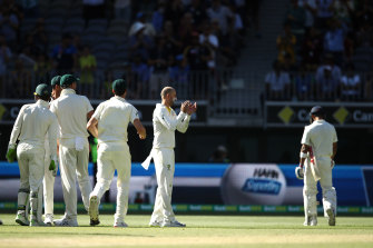 Nathan Lyon (second right) has dismissed Kohli seven times in Tests.
