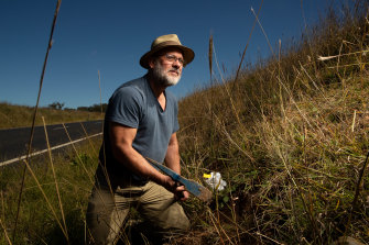 Tim Flannery searches for fossils on the side of the road in the Upper Hunter. He found several bone fragments from mammals that are 4 to 5 million years old.