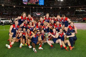 The Demons celebrate their grand final win at Optus Stadium.