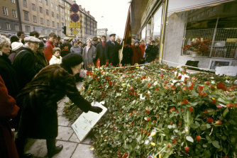 People lay flowers at the site where Olof Palme was shot in 1986.