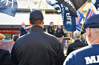 CFMEU WA state secretary Mick Buchan and MUA WA branch secretary Christy Cain speak to the crowd outside Labor Fremantle MLA Simone McGurk's office on Wednesday morning.