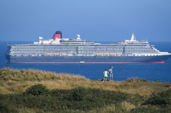 Cruise ship Queen Victoria anchored in the English Channel off the Dorset coast as the industry remains at a standstill.
