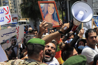 Soldiers push back a man who lost his son during last year's massive blast at the port of Beirut at a protest on Friday.