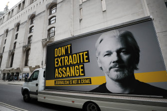 A truck with a billboard of Julian Assange arrives at the Old Bailey court in London during his extradition hearing.