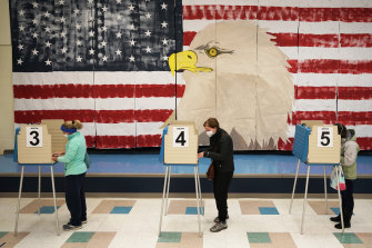 Efforts to distance voters were evident as Americans voted on November 3.