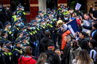Police and protesters come face to face in Melbourne on Saturday.