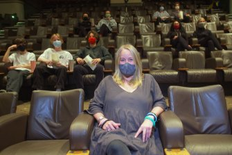 Sun Theatre staff, including Krissa Jansson (front), give socially distant seating a trial run.