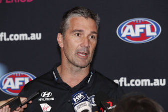 Steve Silvagni speaks to media during AFL trade period in October.