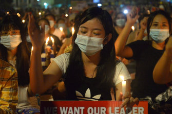 Protesters attend a candlelight night rally in Yangon on Saturday night.